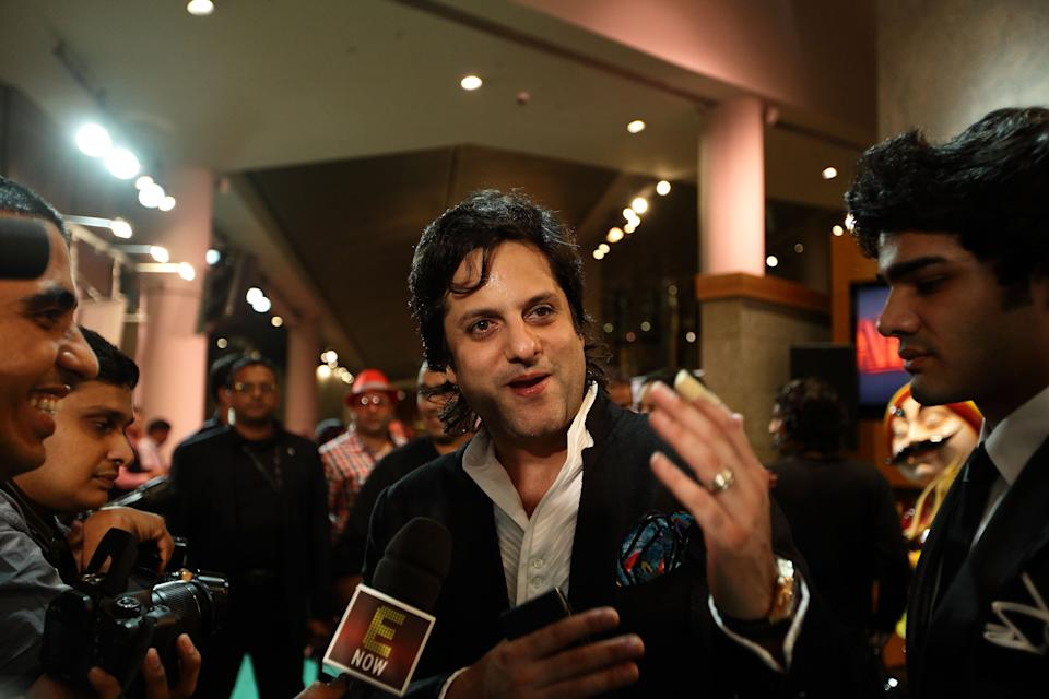 SINGAPORE - JUNE 08:  Indian actor Fardeen Khan speaks to the media on the green carpet during the IIFA Rocks Green Carpet on day two of the 2012 International India Film Academy Award weekend at the Esplanade on June 8, 2012 in Singapore.  (Photo by Suhaimi Abdullah/Getty Images)