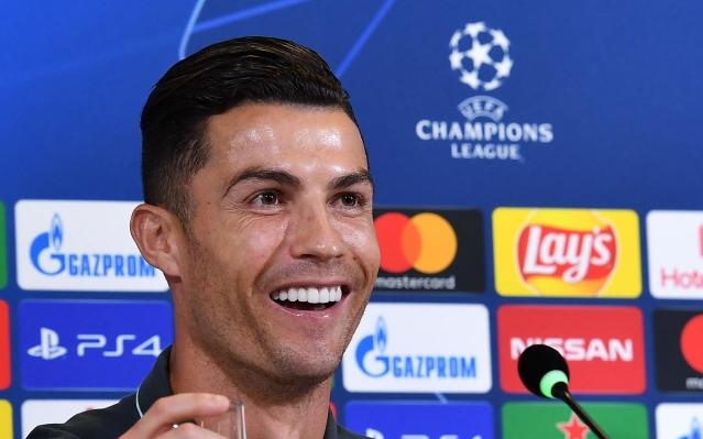 Juventus' Cristiano Ronaldo meets the media ahead of Tuesday's Champions League group D soccer match against Lokomotiv Moscow, at the Allianz stadium in Turin, Italy, Monday, Oct. 21, 2019. (Alessandro Di Marco/ANSA via AP)