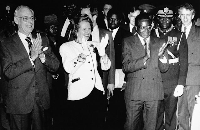 <p>British Prime Minister Margaret Thatcher, accompanied by her husband, arrives at Harare International Airport for a two-day visit to Zimbabwe on March 29, 1981. Thatcher with her husband and Zimbabwean President Robert Mugabe applauded the traditional dancers who greeted them as they stepped off their plane. (Photo: Peter Winterbach/AP) </p>