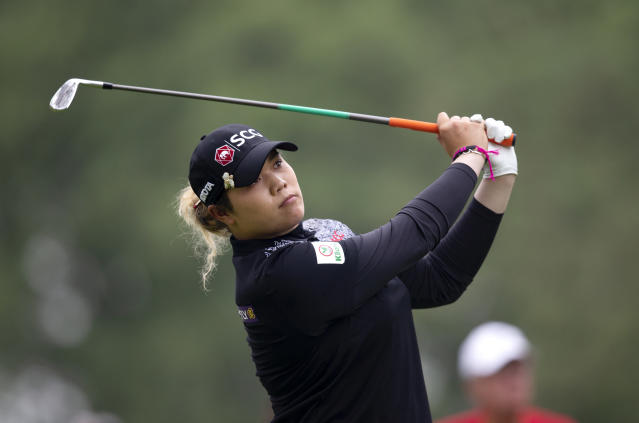Ariya Jutanugarn, of Thailand, tees off on the fourth hole during the final round of the KPMG Women's PGA Championship golf tournament, Sunday, June 23, 2019, in Chaska, Minn. (AP Photo/Andy Clayton-King)