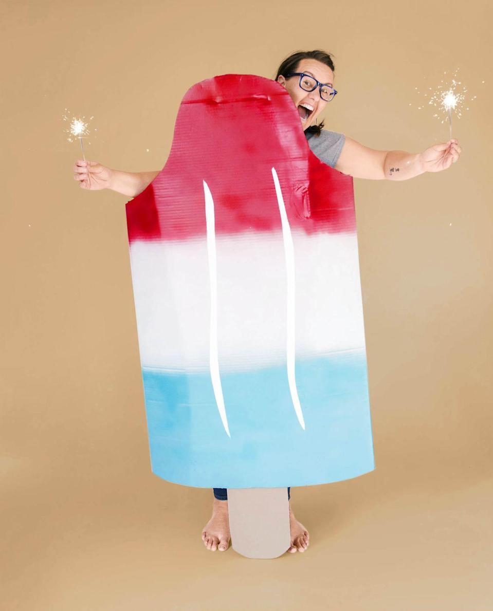 """<p>As sweet (and low effort) as the lazy days of summer, this costume calls for large pieces of cardboard; red, white, and blue spray paint; and white acrylic paint. (Sparklers optional!)<br><br><strong>Get the tutorial at <a href=""""https://ohyaystudio.com/how-to-make-an-easy-bomb-pop-popsicle-costume/"""" rel=""""nofollow noopener"""" target=""""_blank"""" data-ylk=""""slk:Oh Yay Studio"""" class=""""link rapid-noclick-resp"""">Oh Yay Studio</a>.</strong></p>"""