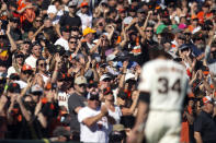 Fans cheer San Francisco Giants starting pitcher Kevin Gausman (34) as he's removed for a reliever at the start of the eighth inning of a baseball game, Saturday, Oct. 2, 2021, in San Francisco. (AP Photo/D. Ross Cameron)