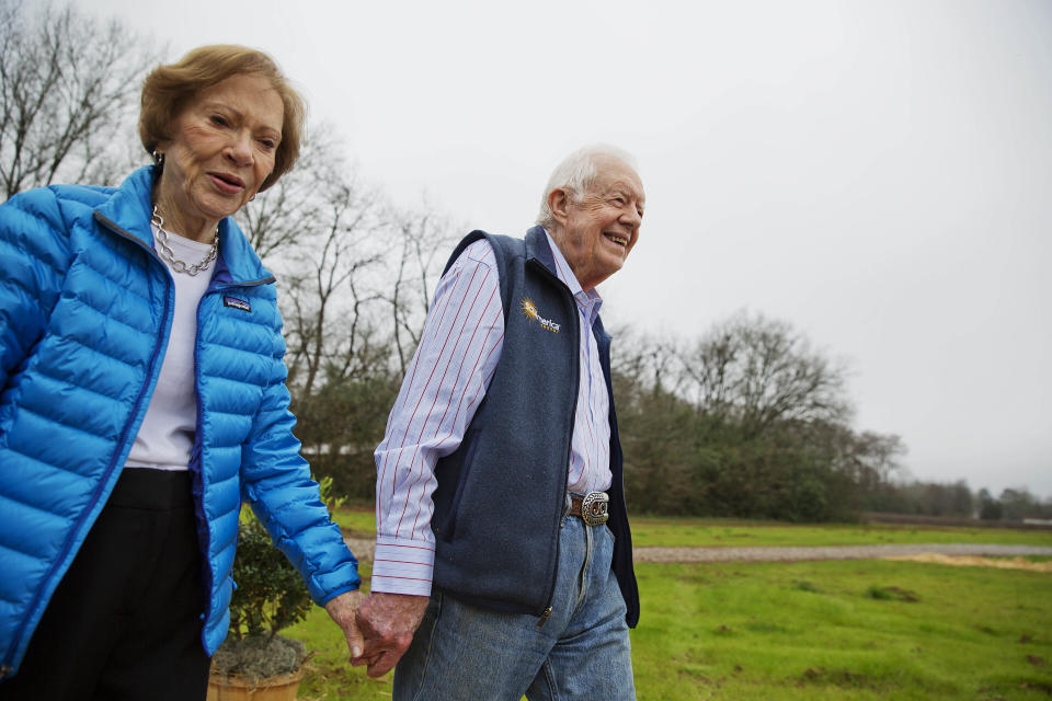 FILE - In this Feb. 8, 2017, file photo former President Jimmy Carter, right, and his wife Rosalynn arrive for a ribbon cutting ceremony for a solar panel project on farmland he owns in their hometown of Plains, Ga. Jimmy Carter and his wife Rosalynn celebrate their 75th anniversary this week on Thursday, July 7, 2021. (AP Photo/David Goldman, File)