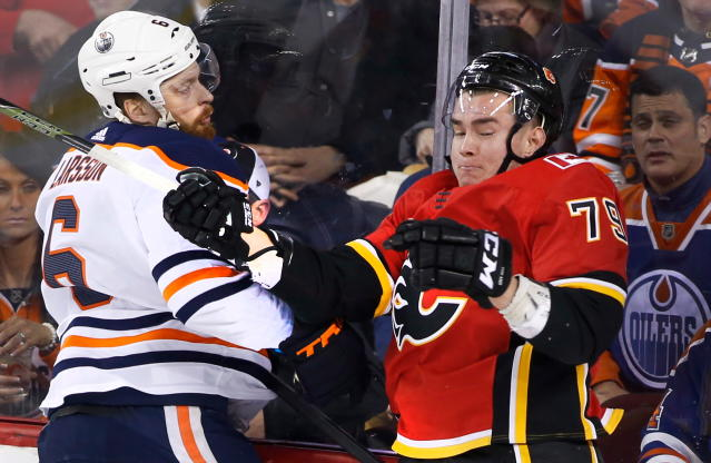 Edmonton Oilers' Adam Larsson (6), of Sweden, hits Calgary Flames' Micheal Ferland (79) during second period NHL action in Calgary on Saturday, March 31, 2018. (Larry MacDougal/The Canadian Press via AP)