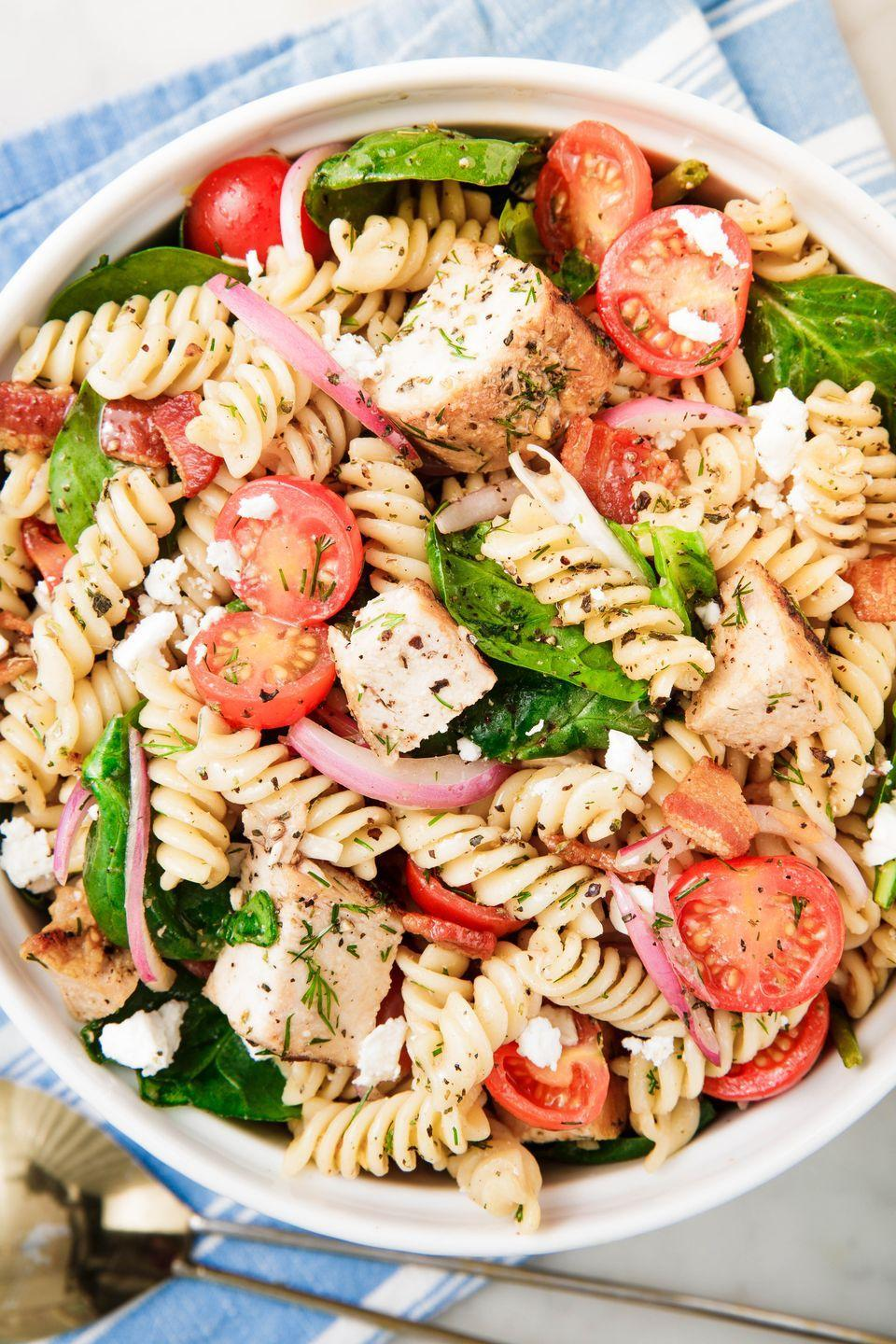 "<p>It might not be BBQ season yet, but this pasta salad will get you all geared up.</p><p>Get the recipe from <a href=""https://www.delish.com/cooking/recipe-ideas/a25136514/chicken-pasta-salad/"" rel=""nofollow noopener"" target=""_blank"" data-ylk=""slk:Delish"" class=""link rapid-noclick-resp"">Delish</a>.</p>"