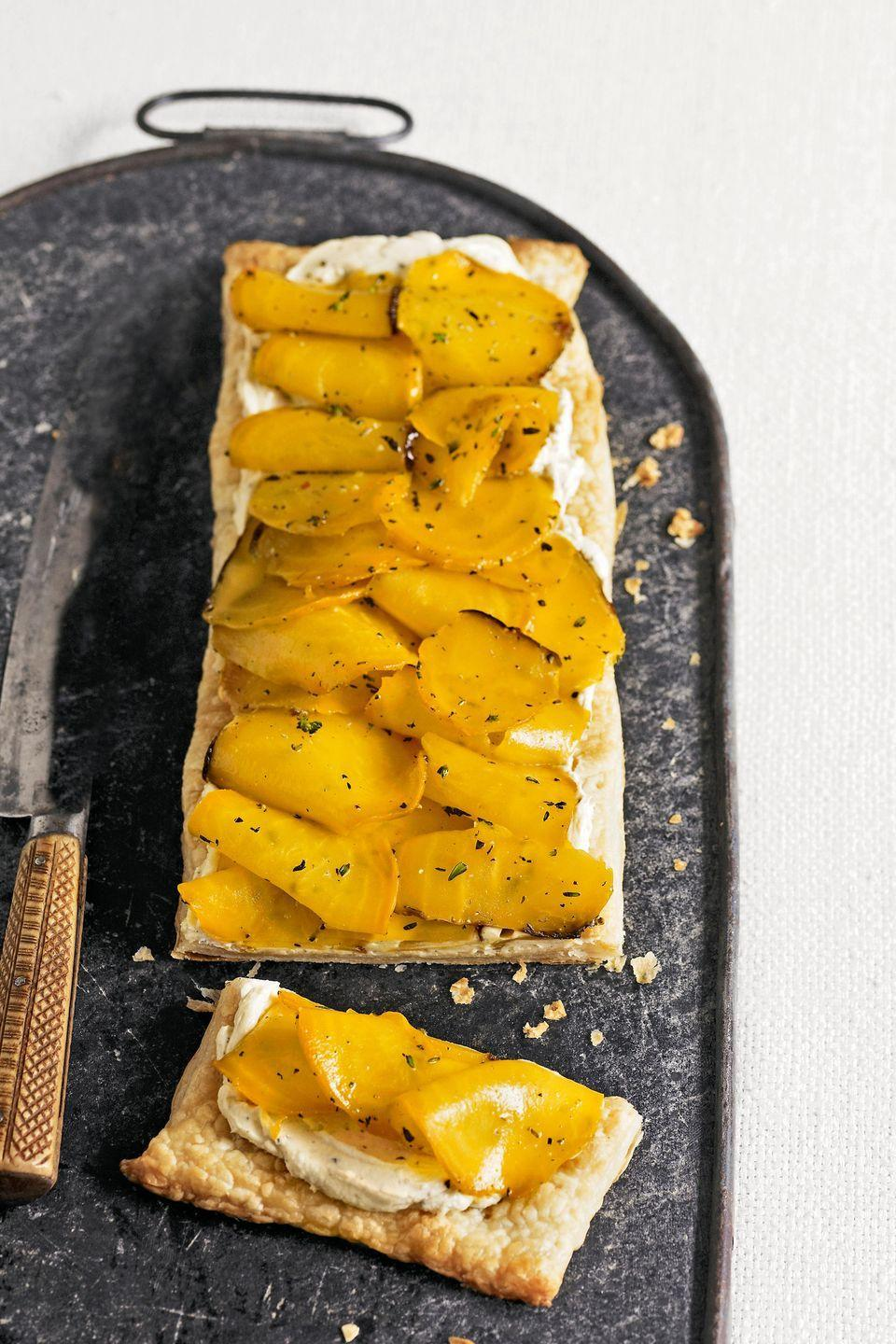 "<p>This delicious tart can be served as both a side dish and savory dessert. </p><p><strong><a href=""https://www.countryliving.com/food-drinks/recipes/a5496/golden-beet-tart-recipe/"" rel=""nofollow noopener"" target=""_blank"" data-ylk=""slk:Get the recipe"" class=""link rapid-noclick-resp"">Get the recipe</a>.</strong></p><p><a class=""link rapid-noclick-resp"" href=""https://www.amazon.com/Nordic-Ware-Natural-Aluminum-Commercial/dp/B0049C2S32/?tag=syn-yahoo-20&ascsubtag=%5Bartid%7C10063.g.35089489%5Bsrc%7Cyahoo-us"" rel=""nofollow noopener"" target=""_blank"" data-ylk=""slk:SHOP BAKING SHEETS"">SHOP BAKING SHEETS</a></p>"