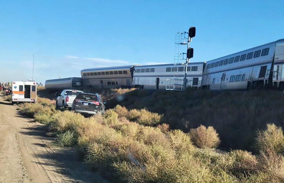In this photo provided by Kimberly Fossen an ambulance is parked at the scene of an Amtrak train derailment on Saturday, Sept. 25, 2021, in north-central Montana. Multiple people were injured when the train that runs between Seattle and Chicago derailed Saturday, the train agency said.