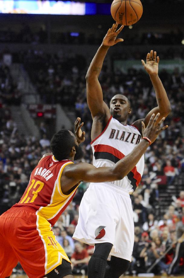 Houston Rockets's James Harden (13) defends a shot by Portland Trail Blazers' Wesley Matthews (2) during the second half of an NBA basketball game in Portland, Ore.,Thursday Dec. 12, 2013. Portland beat the Rockets 111-104. (AP Photo/Greg Wahl-Stephens)