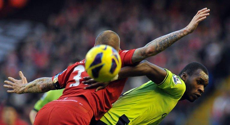 Aston Villa's Christian Benteke (R) and Liverpool's Martin Skrtel compete in Liverpool on December 15, 2012