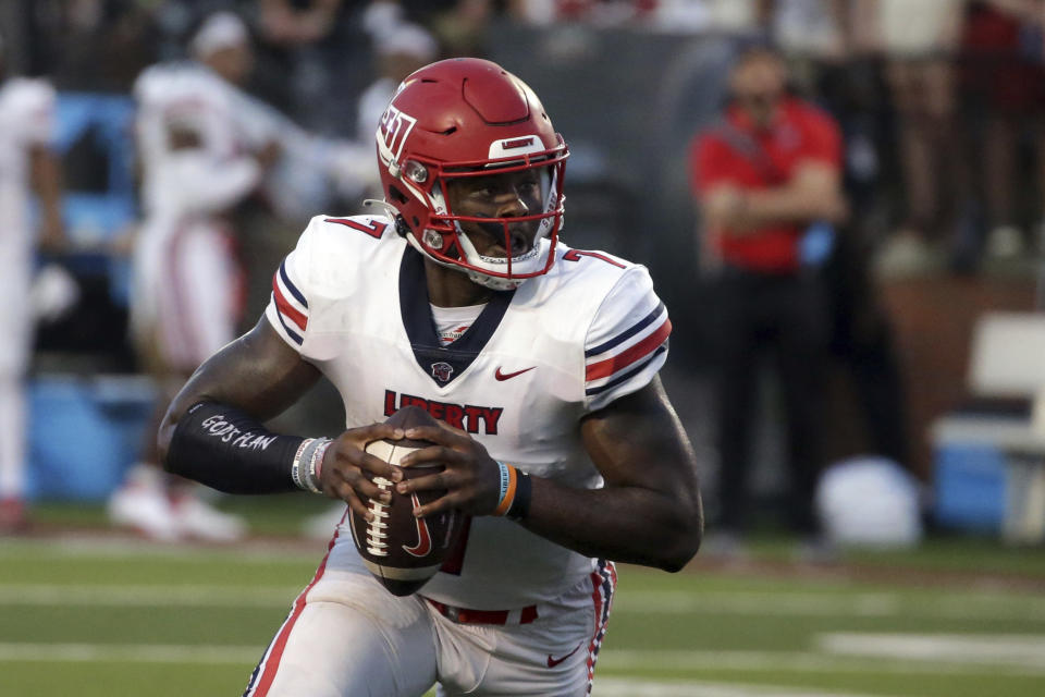Liberty quarterback Malik Willis has a chance to win for a second time at Syracuse and boost his already simmering NFL draft stock. (AP Photo/Butch Dill, File)