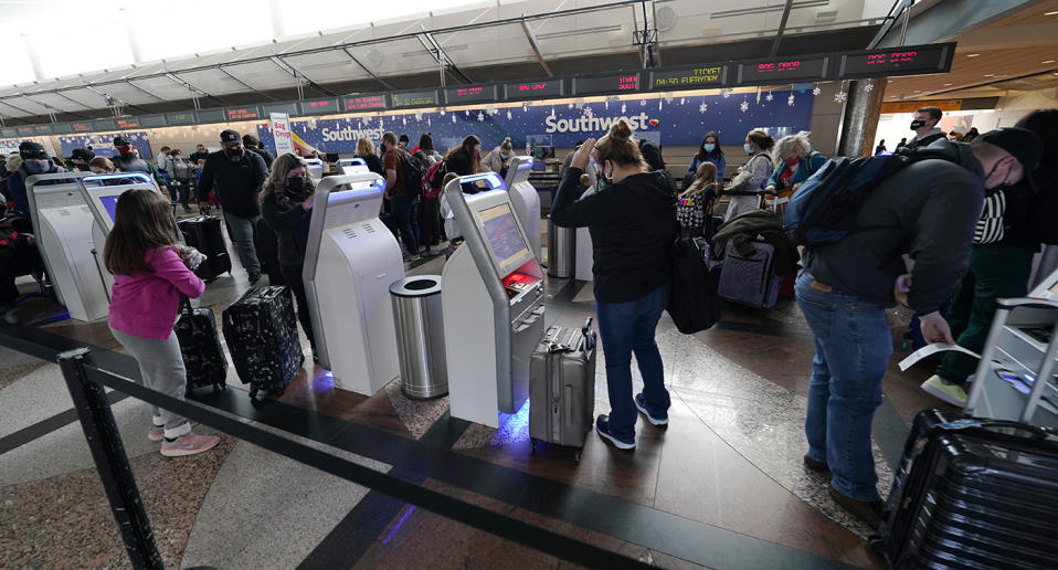 There have been confronting scenes at US airports overnight as millions travel head of the holidays. Source: AP