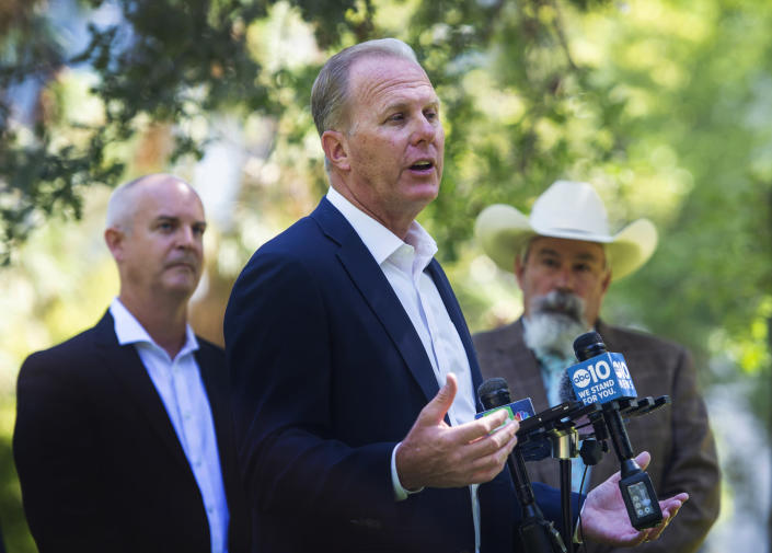 """Former San Diego Mayor and Republican candidate for governor, Kevin Faulconer, speaks about his plan to prevent wildfires during a press conference at Capitol Park in Sacramento, Calif., on Tuesday, July 13, 2021. Faulconer says he'd declare a state of emergency over California wildfires on his first day in office as he works to put the state on """"war footing"""" to prevent worsening blazes. Faulconer released his one-page wildfire plan Tuesday amid days of scorching temperatures and fires across the U.S. West. (Sara Nevis/The Sacramento Bee via AP)"""