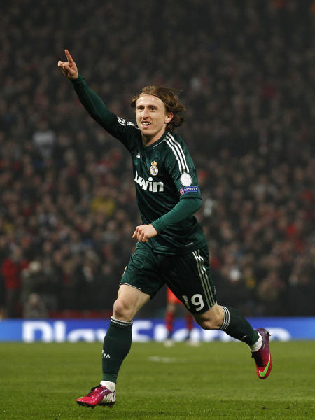 Real Madrid's Luka Modric from Croatia celebrates after scoring against Manchester United during their Champions League round of 16 soccer match at Old Trafford Stadium, Manchester, England, Tuesday, March 5, 2013. (AP Photo/Jon Super)
