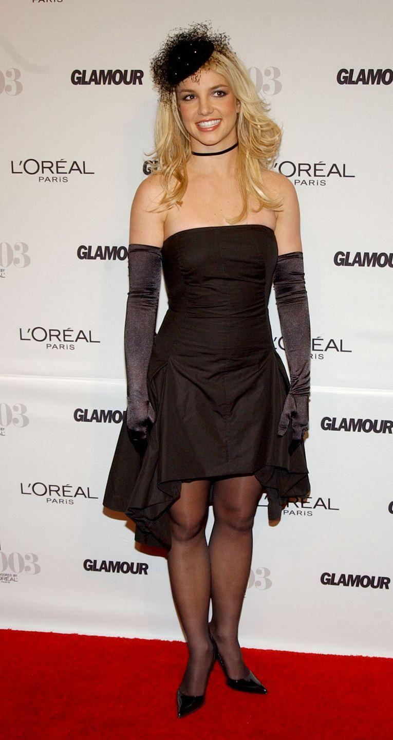 <p>Britney Spears dons a strapless black dress and long black gloves for the 14th Annual GLAMOUR Women of the Year Awards.</p>