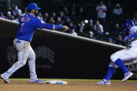 New York Mets second baseman Jonathan Villar (1) forces out Chicago Cubs' Javier Baez (9) at second base and then throws to first base to complete a double play during the seventh inning of a baseball game, Thursday, April, 22, 2021, in Chicago. (AP Photo/David Banks)