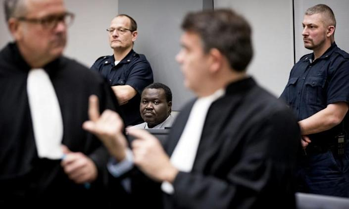 Patrice-Edouard Ngaissona, pictured centre in 2019, is on trial in The Hague for war crimes as many victims in Central African Republic hope for justice