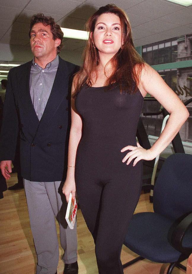 Alicia Machado posed with her trainer, Edward Jackowski, before beginning a workout in front of cameras, in 1997. (Photo: JON LEVY/AFP/Getty Images)