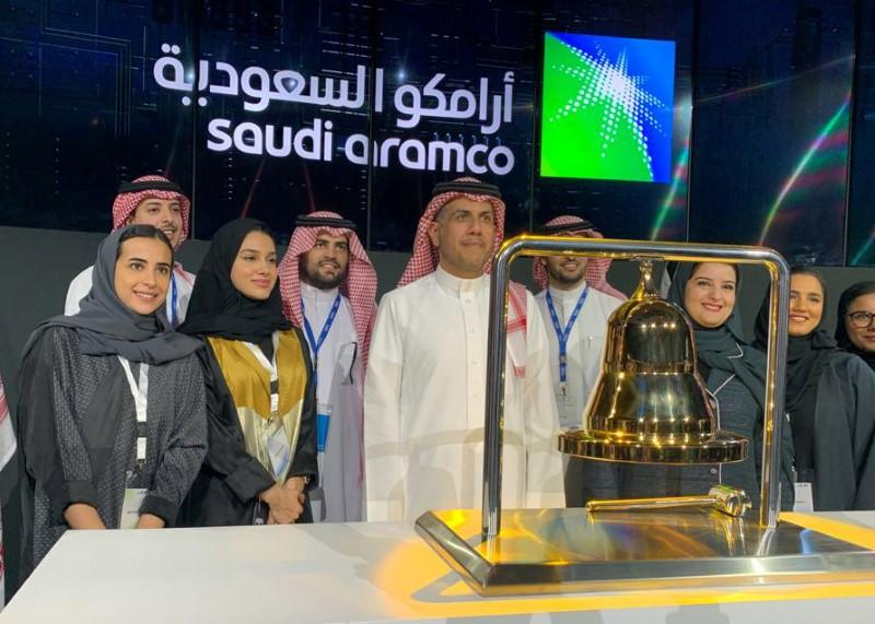 Participants attend the official ceremony marking the debut of Saudi Aramco's IPO on the Riyadh's stock market, in Riyadh