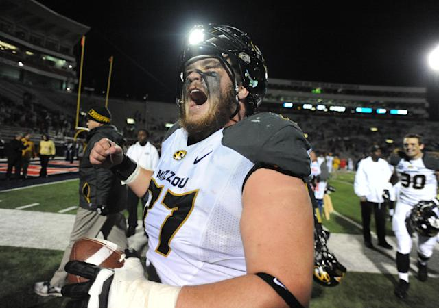 Missouri's Evan Boehm (77) celebrates a win over Mississippi at Vaught-Hemingway Stadium in Oxford, Miss. on Saturday, November 23, 2013. Missouri won 24-10. (AP Photo/Oxford Eagle, Bruce Newman)