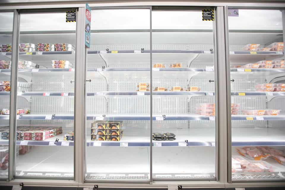 Empty shelves are seen in the meat aisle of Co-Op supermarket, Harpenden, Britain, September 22, 2021.  REUTERS/Peter Cziborra