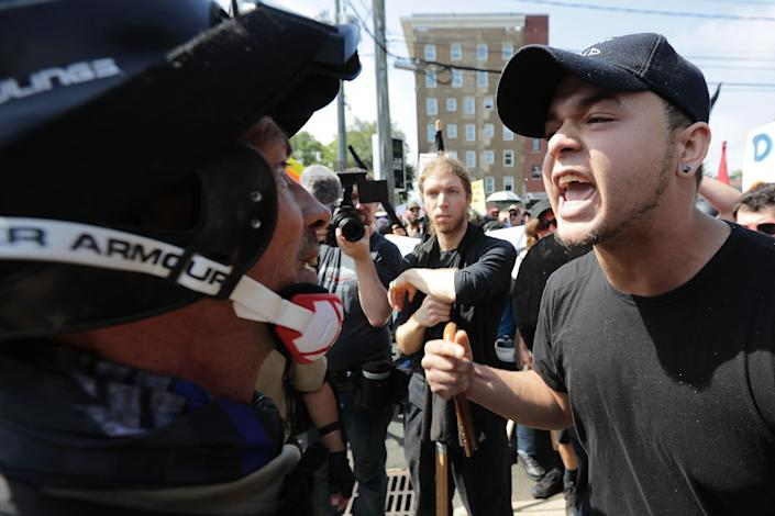 """<p>White nationalists, neo-Nazis and members of the """"alt-right"""" exchange insults with counter-protesters as they enter Lee Park during the """"Unite the Right"""" rally August 12, 2017 in Charlottesville, Virginia. After clashes with anti-fascist protesters and police the rally was declared an unlawful gathering and people were forced out of Lee Park, where a statue of Confederate General Robert E. Lee is slated to be removed. (Photo: Chip Somodevilla/Getty Images) </p>"""