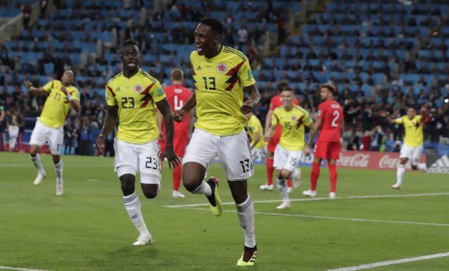 <p>Heartbreak for England: Colombia's Yerry Mina celebrates after scoring an injury-time equaliser </p>