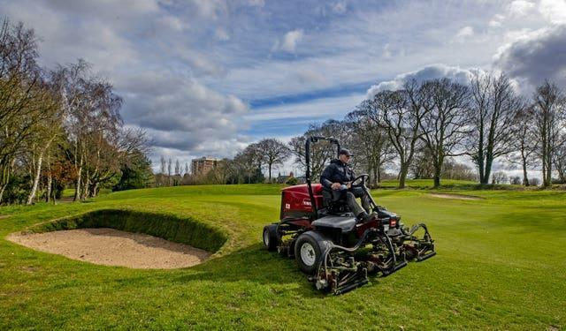 Greenkeepers at Allerton Manor golf course in Liverpool prepare the course ahead of reopening (Peter Byrne/PA)