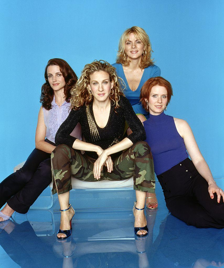 """Kristin Davis, Sarah Jessica Parker, Kim Cattrall and Cynthia Nixon promote the third season of """"Sex And The City"""" in 2000. (Photo: HBO/Newsmakers)"""
