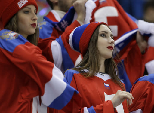 Fans wait before the semifinal round of the men's hockey game between the team from Russia and the Czech Republic at the 2018 Winter Olympics in Gangneung, South Korea, Friday, Feb. 23, 2018. (AP Photo/Julio Cortez)