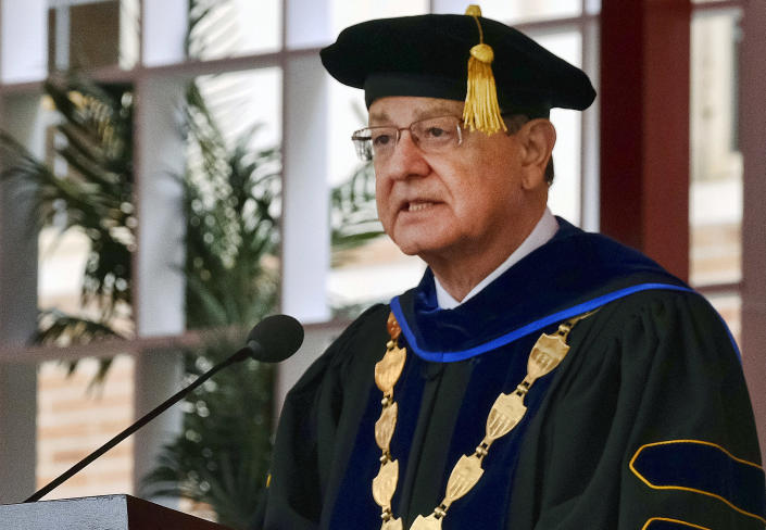 FILE - In this May 12, 2017 file photo, University of Southern California President C.L. Max Nikias attends the University of Southern California's Commencement Ceremony at Alumni Park in Los Angeles. The past year has been a bruising one for the Los Angeles university. The president who helped boost the school's endowment above $6 billion had to step down amid investigations into a medical school dean accused of smoking methamphetamine with a prostitute who overdosed, its longtime gynecologist was accused of sexual misconduct by hundreds of women he examined over decades and an assistant men's basketball coach pleaded guilty to charges stemming from an FBI probe of corruption in college basketball. (AP Photo/Richard Vogel, File)