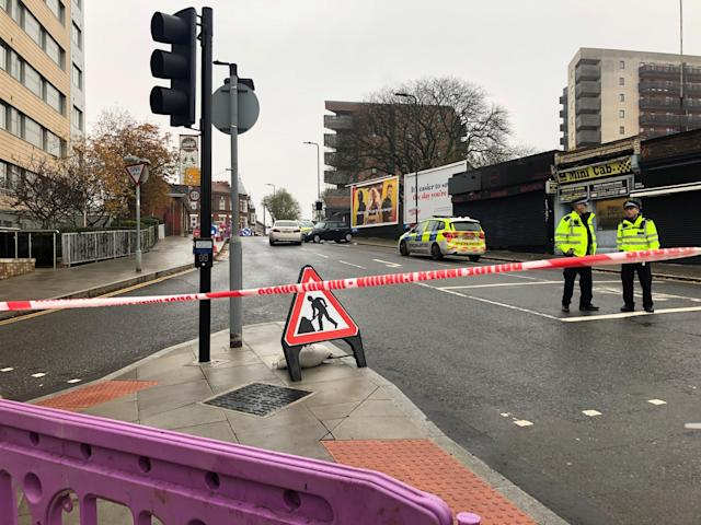 The scene outside West Ealing railway station where a man died after being stabbed before crashing his vehicle into another car in west London. (PA)
