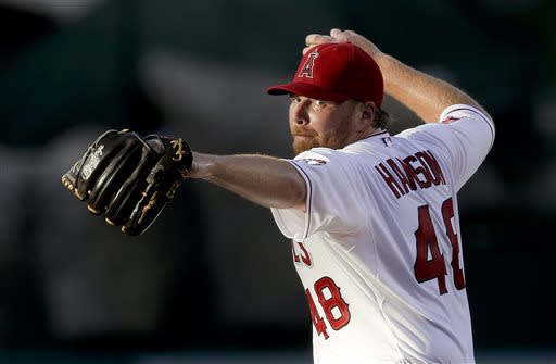 Los Angeles Angels starting pitcher Tommy Hanson throws to the Seattle Mariners during the first inning of a baseball game in Anaheim, Calif., Thursday, June 20, 2013. (AP Photo/Chris Carlson)