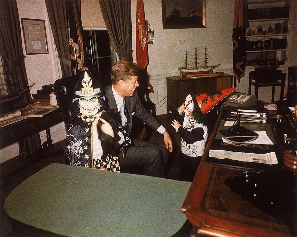 <p>This heartbreaking photo was taken just weeks before JFK's assassination as he previewed children Caroline<em> (left)</em> and John Junior's Halloween costumes in 1963. </p>