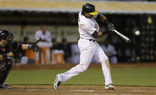 Oakland Athletics' Coco Crisp connects for an RBI single odd Detroit Tigers' Drew Smyly in the seventh inning of a baseball game Friday, April 12, 2013, in Oakland, Calif. (AP Photo/Ben Margot)