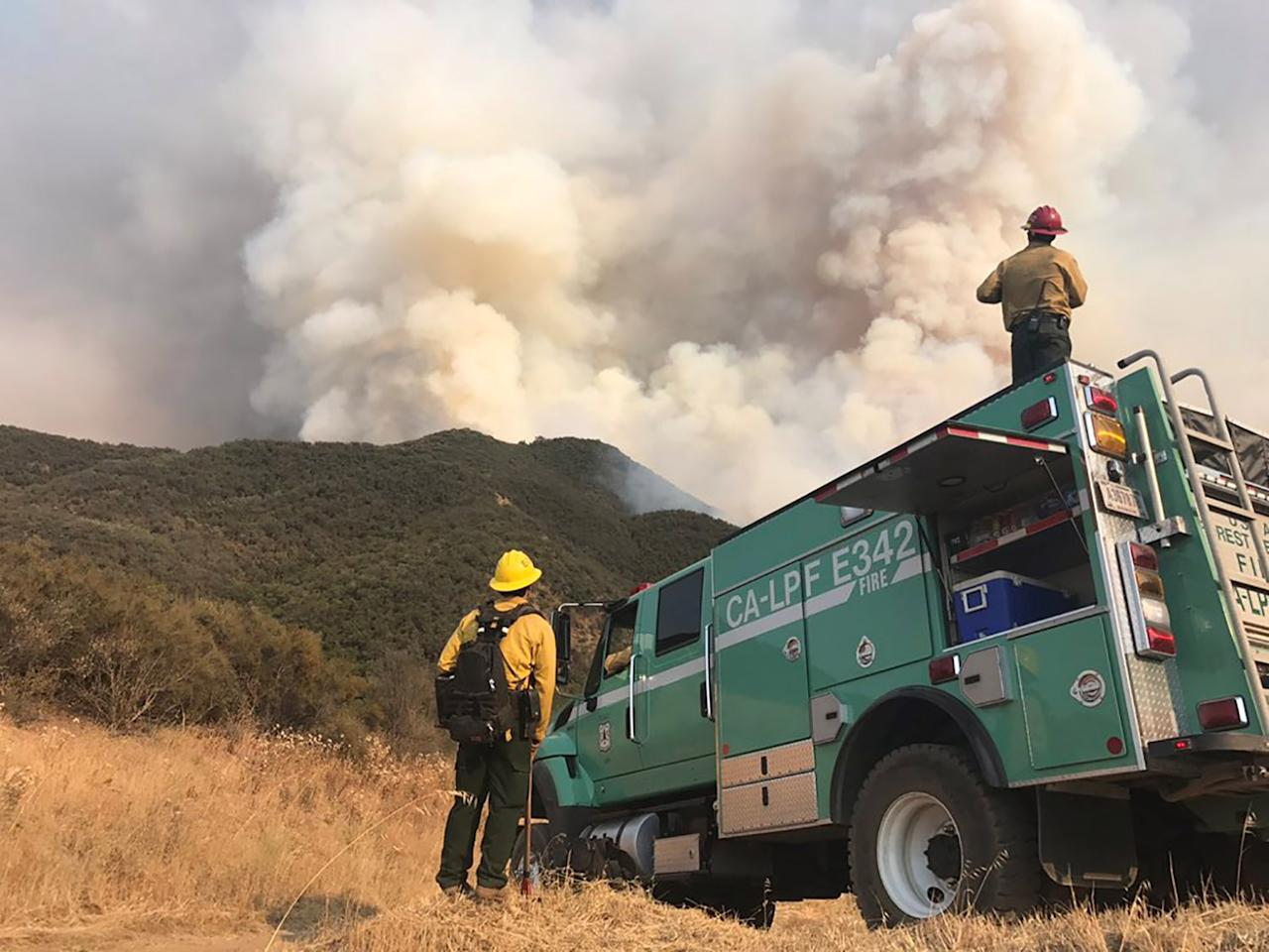<p>Los Padres National Forest firefighters watch the northeast flank of the Whittier fire near Hot Spring Canyon outside Cachuma Lake, California, U.S. July 11, 2017. (Mike Eliason/Santa Barbara County Fire/Handout via Reuters) </p>