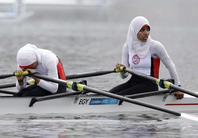 Egypt's Fatma Rashed, left, and Sara Mohamed Baraka recover after finishing last in a lightweight women's rowing double sculls repechage in Eton Dorney, near Windsor, England, at the 2012 Summer Olympics, Tuesday, July 31, 2012. (AP Photo/Natacha Pisarenko)
