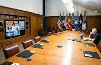 In this photo released by The White House, President Joe Biden meets virtually with his national security team and senior officials for a briefing on Afghanistan in August 2021, at Camp David