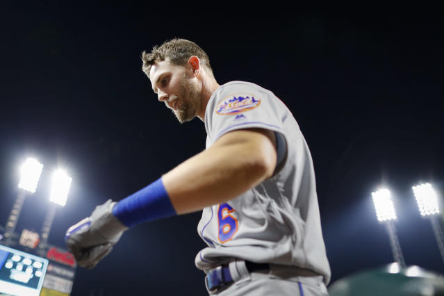 New York Mets' Jeff McNeil celebrates after hitting a solo home run off Cincinnati Reds starting pitcher Luis Castillo in the sixth inning of a baseball game Friday, Sept. 20, 2019, in Cincinnati. (AP Photo/John Minchillo)