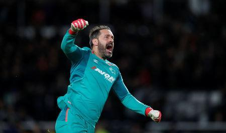 Soccer Football - Championship - Derby County v Cardiff City - Pride Park, Derby, Britain - April 24, 2018 Derby County's Scott Carson celebrates their second goal Action Images/Andrew Boyers