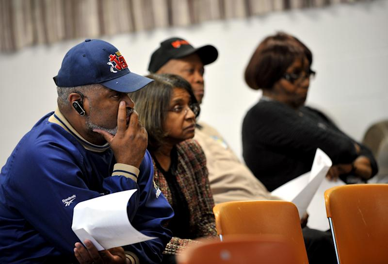 In a photo from March 26, 2012 Muskegon Heights resident Jerry Riley, pictured from left, along with Joyce Phelps, Joe Warren of Muskegon Township, and Pauline McDowell of Muskegon Township, listen to the regular Muskegon Heights Public School Board meeting. Both Riley and Warren spoke about their concerns to the board. (AP Photo/ Kendra Stanley-Mills)