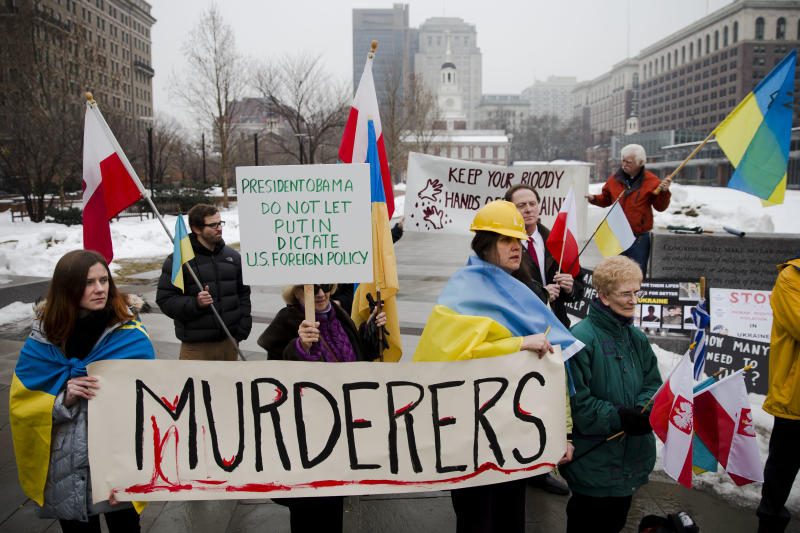 Members of the Ukrainian American and Polish American communities demonstrate in support Ukrainian anti-government protesters outside Independence Hall, Wednesday, Feb. 19, 2014, in Philadelphia. The violence on Tuesday was the worst in nearly three months of anti-government protests that have paralyzed Ukraine's capital, Kiev, in a struggle over the identity of a nation divided in loyalties between Russia and the West, and the worst in the country's post-Soviet history. (AP Photo/Matt Rourke)