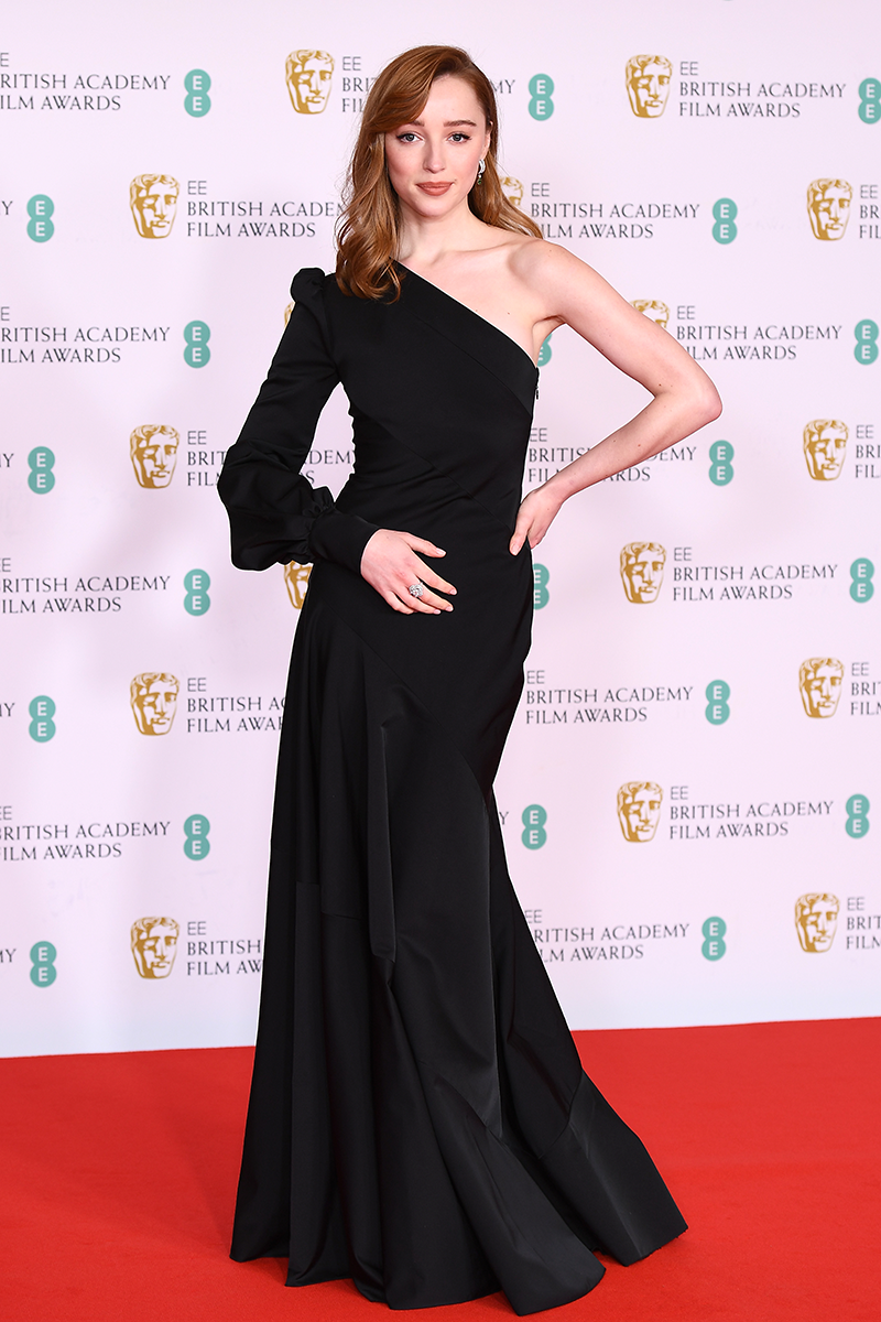 <p>Phoebe Dynevor opts for a one-shoulder gown with a puff sleeve, subtle fishtail skirt and minimalist jewellery.</p>