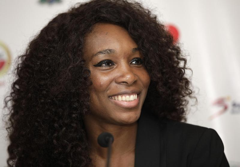 U.S Tennis star Venus WIlliams smiles during a press conference in Lagos, Nigeria. Wednesday, Oct. 31, 2012. Tennis stars Serena and Venus Williams say they eagerly await playing in the 2016 Olympics after their third doubles gold this year. The two sisters made the comments Wednesday in Lagos, Nigeria's largest city, during their first visit to the country. (AP Photo/Sunday Alamba)