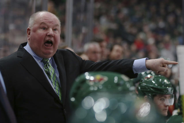 "FILE - In this Jan. 12, 2020, file photo, Minnesota Wild's head coach Bruce Boudreau shouts after a penalty call in the second period of an NHL hockey game against the Vancouver Canucks in St. Paul, Minn. Boudreau played for the team the movie ""Slap Shot"" was based off of and has a non-speaking role. His recollections include the 10 hours a day in uniform waiting to shoot a scene, how brutally real some of the big hits were and the night he got to spend with Paul Newman, director George Roy Hill and Dave Hanson in the film room. ""Paul turns around to me at the one point and he said: 'This is gonna be a great movie. Trust me,'"" Boudreau recalled. "" And I'll never forget it. ... He was right.""(AP Photo/Stacy Bengs, File)"