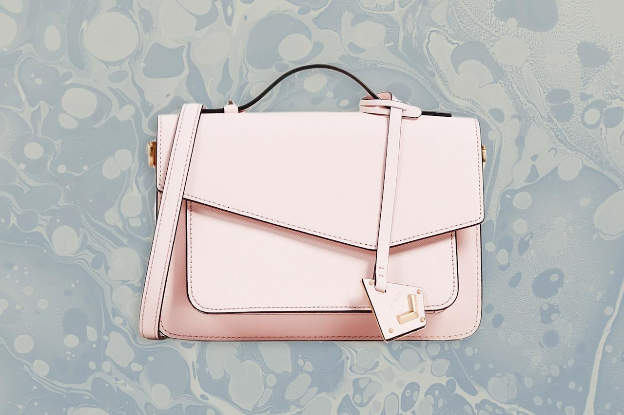 """<p><strong>Best For:</strong> The subtly stylish traveler</p> <p>Between the asymmetrical front and the pale pink shade, this Botkier bag combines style and function seamlessly. The roomy interior has ample space for all of your travel essentials, and there's even a zipper pocket to safely store loose items like keys or lip balm.</p> <p><strong>Buy Now:</strong> $198, <a href=""""https://fave.co/2OHUTE3"""" rel=""""nofollow"""" target=""""_blank"""">shopbop.com</a></p>"""