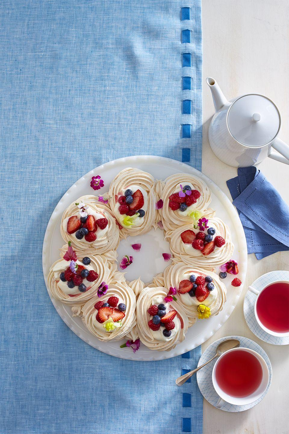 """<p>The lightness of the meringue along with the refreshing fruit is the ideal warm-weather combo. </p><p><em><strong><a href=""""https://www.womansday.com/food-recipes/food-drinks/recipes/a58133/meringue-wreath-recipe/"""" rel=""""nofollow noopener"""" target=""""_blank"""" data-ylk=""""slk:Get the Meringue Wreath recipe."""" class=""""link rapid-noclick-resp"""">Get the Meringue Wreath recipe. </a></strong></em></p>"""