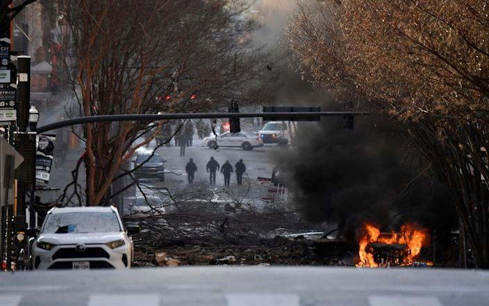 A vehicle burns near the site of an explosion in the downtown Nashville, Tennessee - Andrew Nelles/Tennessean.com/USA TODAY NETWORK via REUTERS