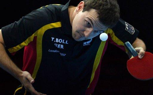 Germany's Timo Boll serves