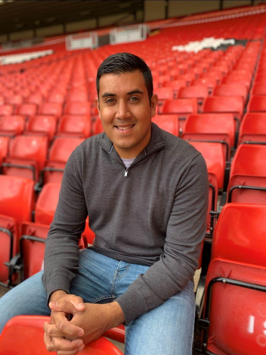 Liverpool's senior manager equality, diversity and inclusion Rishi Jain sat in the stand at Anfield
