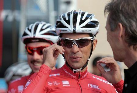 Trek Segafredo cyclist Alberto Contador of Spain gestures before taking part in a training session in El Arenal